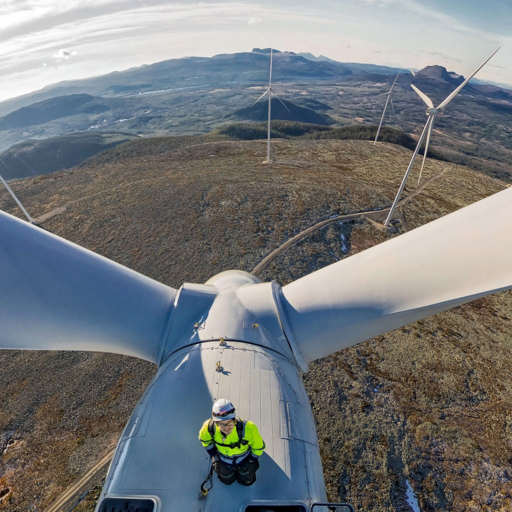 Anders Bäckelin, technician at Vestas, on top of one of the 80 meter high turbines. Photo: Jann Lipka.